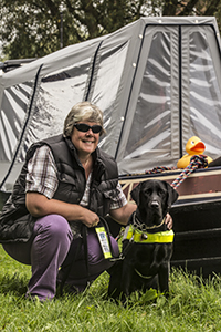 "Guide Dog Oakley with ""Mum"" Tracey Clarke alongside their home ""nb Sola Gratia"""